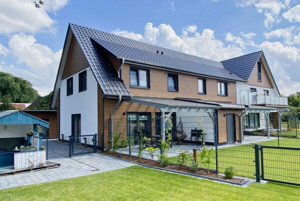 sanierung-mehrfamilienhaus-nachher-holz